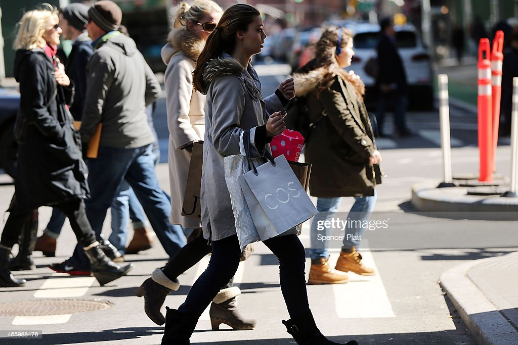 People walk with shopping bags in Manhattan on March 12 2015 in New York City For a third straight month in February US retail sales unexpectedly...