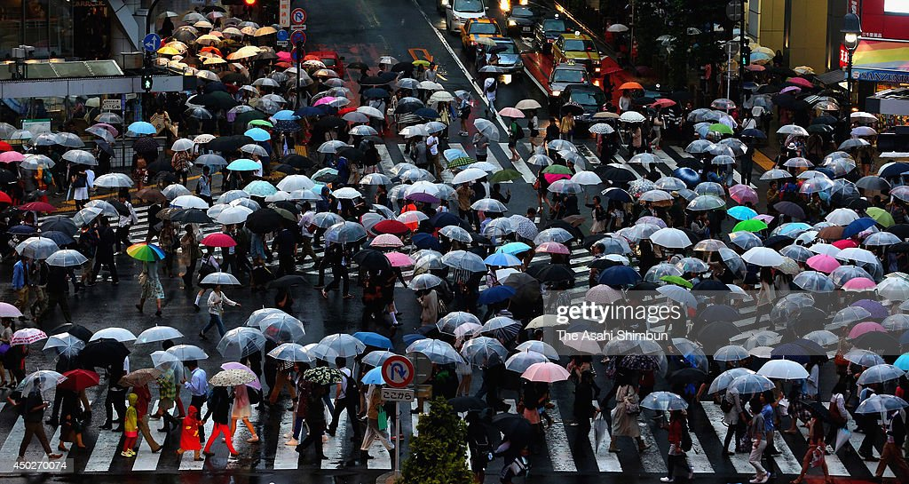 People walk with unbrellas at Shinjuku station on June 6, 2014 in Tokyo, Japan. The Japan Meteorological Agency announced the rainy season started in Kanto area yesterday.