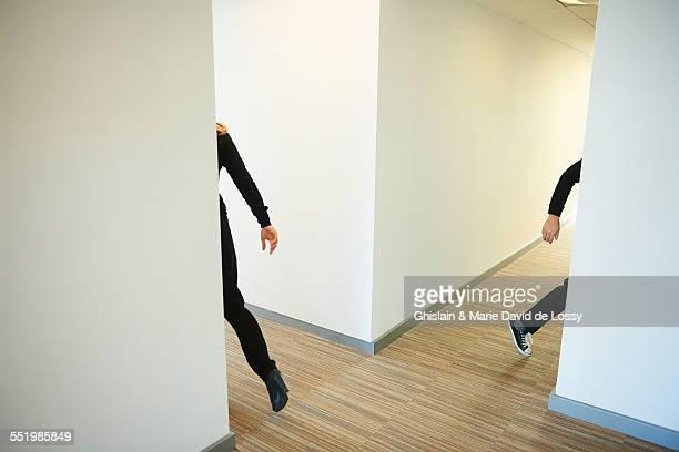 People walking across corridor