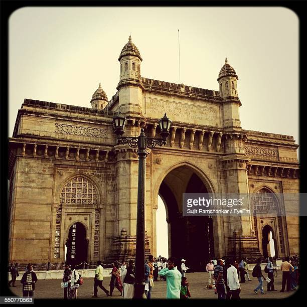 People Walking Against Gateway Of India And Clear Sky