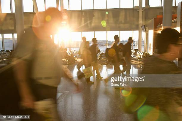 People walking at airport (blurred motion)