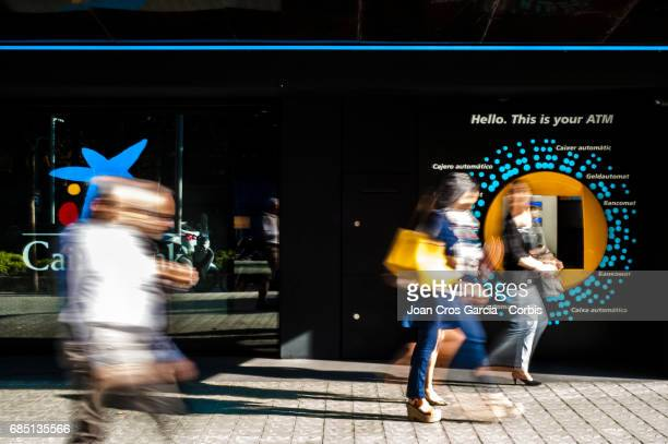 People walking by a Caixa Bank office on May 17 2017 in Barcelona Spain 'n'n