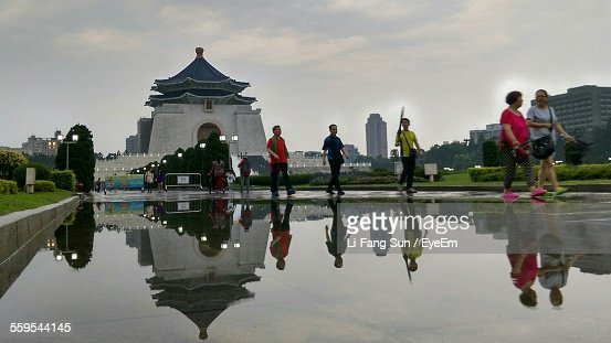 People Walking By Pond Against Chiang Kai-Shek Memorial Hall