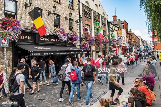 People walking down a busy street in Dublin