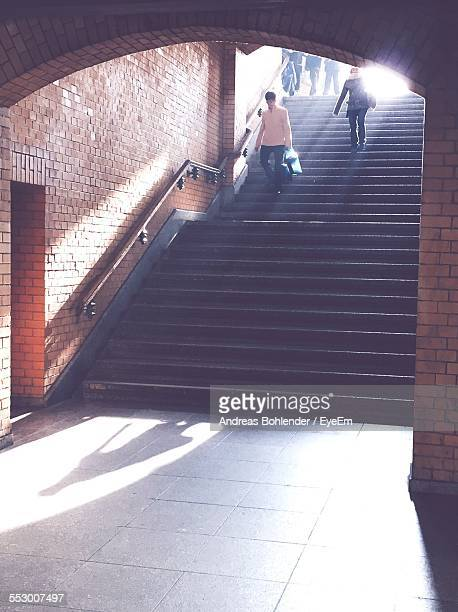 People Walking Down Stairs At Subway Station