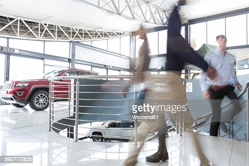 People walking in car dealership
