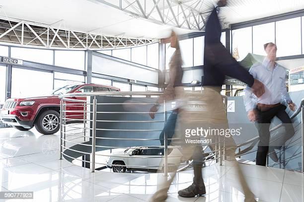 People walking in car dealership