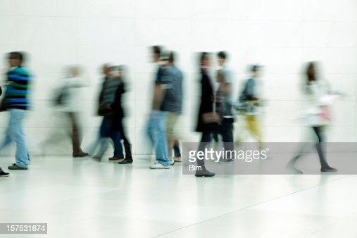 People walking in corridor, blurred motion