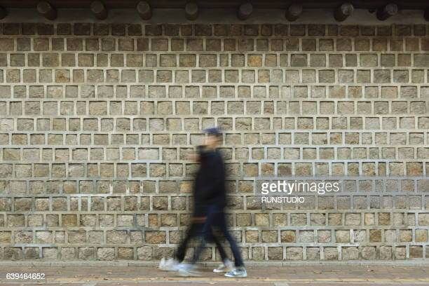 People walking in front of Gyeongbokgung Palace