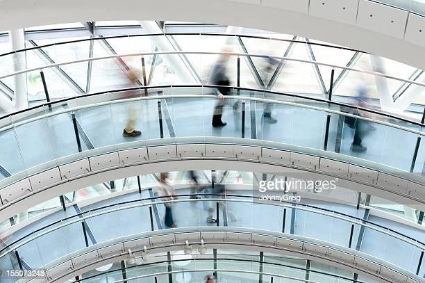 People Walking in Modern Architecture
