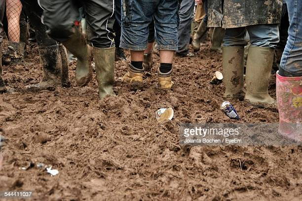 People Walking In Mud In Rubber Boots