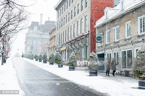 People Walking in Old Montreal on Cold Snowing Winter Day