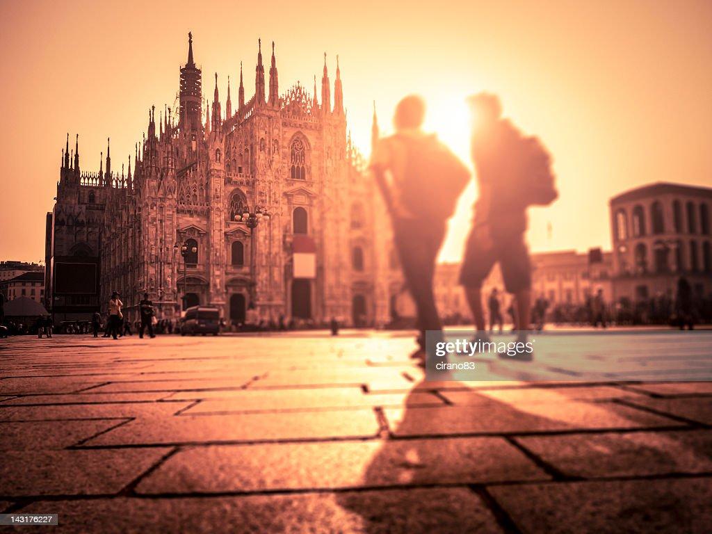 People Walking In Piazza Duomo At Sunset