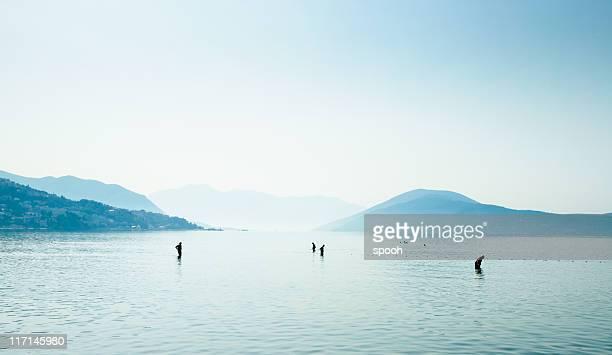 People walking in shallow water on Montenegro coast