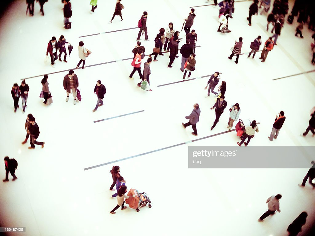 People walking in shopping mall, Hong Kong : Stock Photo