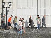 People walking in street, side view