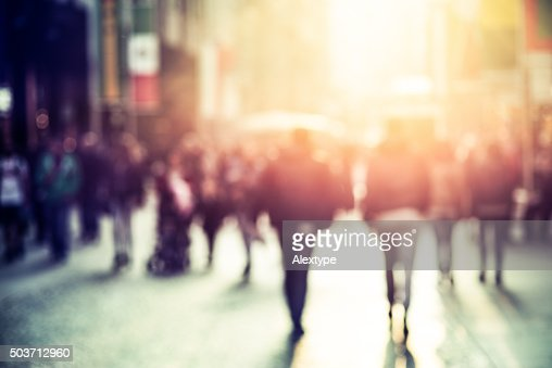 people walking in the street, blurry : Stock Photo