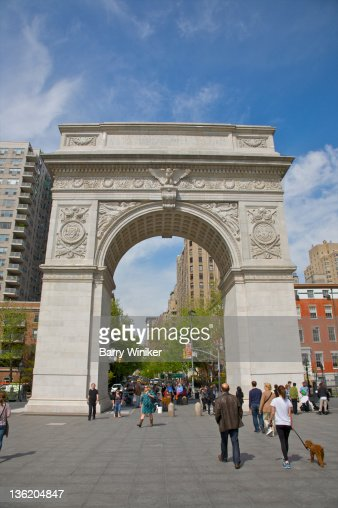 People walking near arch in Washington Square Park