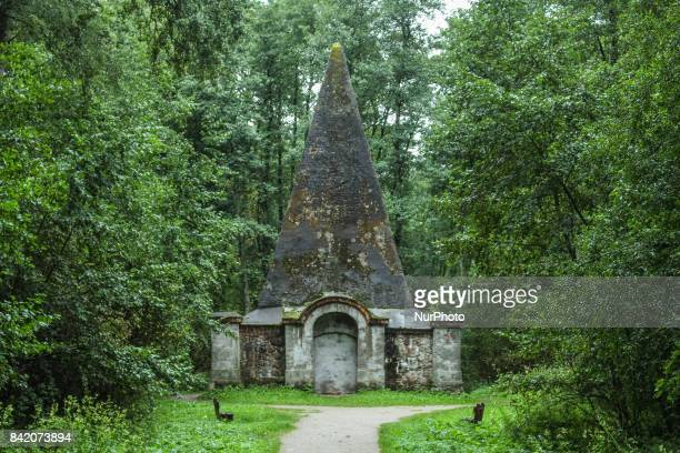 People walking near the Rapa Pyramide are seen on 2 September 2017 in Rapa Poland The Rapa Pyramid was built by Friedrich Heinrich Fahrenheit an...