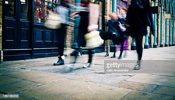 People walking oln street with shopping bags