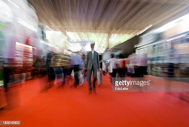 People walking on a red carpet
