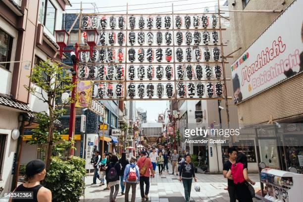 People walking on a shopping street in Asakusa district, Tokyo