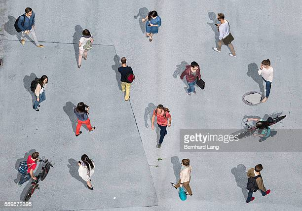 People walking on asphalt underground, Aerial View
