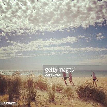 People walking on beach on hot summer day : Stock Photo