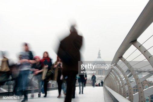 People walking on Millennium Bridge London : Stock Photo