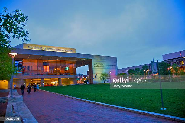 People walking on path near facade of new National Constitution Center, on the Independence Mall in Philadelphia, Pennsylvania