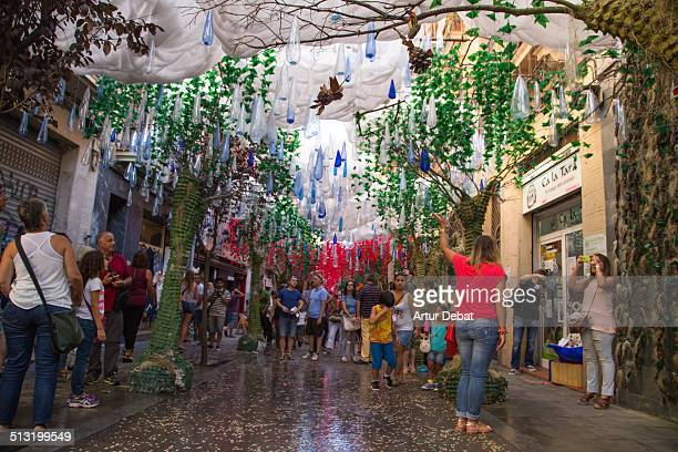 People walking on the Barcelonas decorated streets