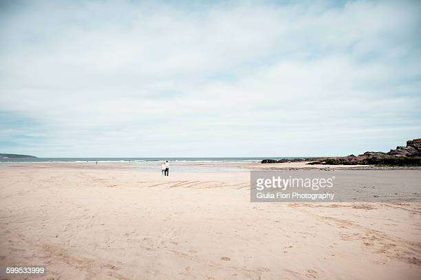 People walking on the beach in Gwithian, Cornwall