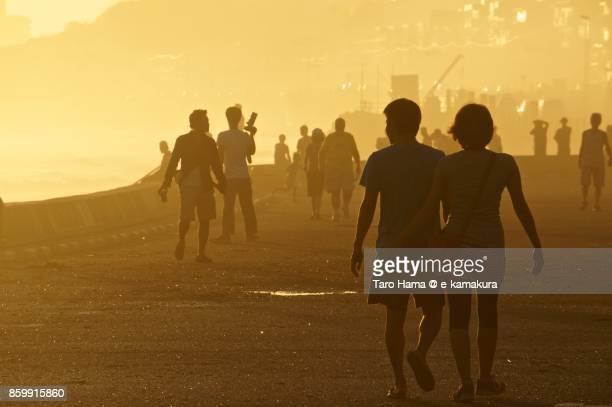 People walking on the sunset beach in Kamakura city in Kanagawa prefecture in Japan
