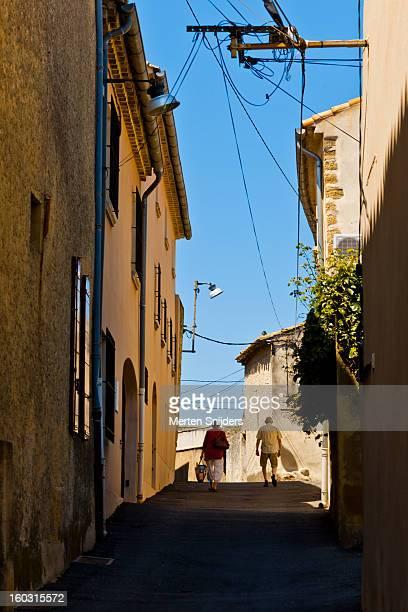 People walking on uphill street