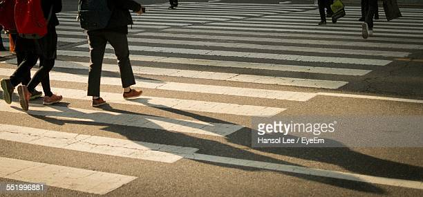 People Walking On Zebra Crossing