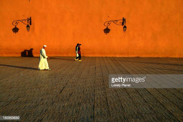People walking outside walls of Koutoubia Mosque.