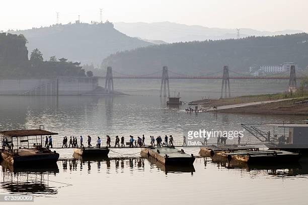 People walking over bridge, Yangtze River, China