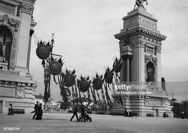 People walking past the Triumphant Arches at the PanAmerican Exposition held in Buffalo New York from May 1st to November 2nd 1901