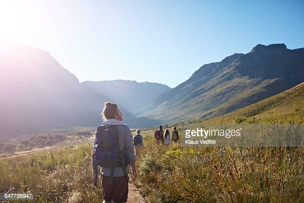 People walking path, in mountain scenery