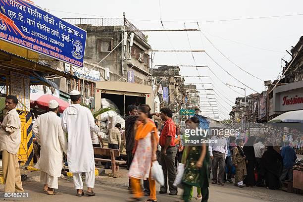 People walking through a market