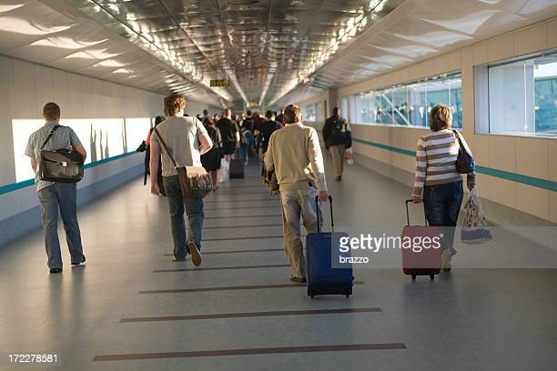 People walking through a terminal at an airport