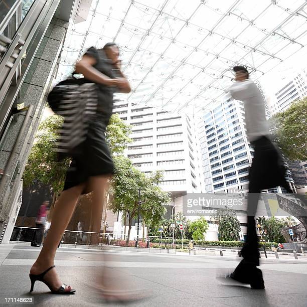 People walking through Singapore's Central Business District.