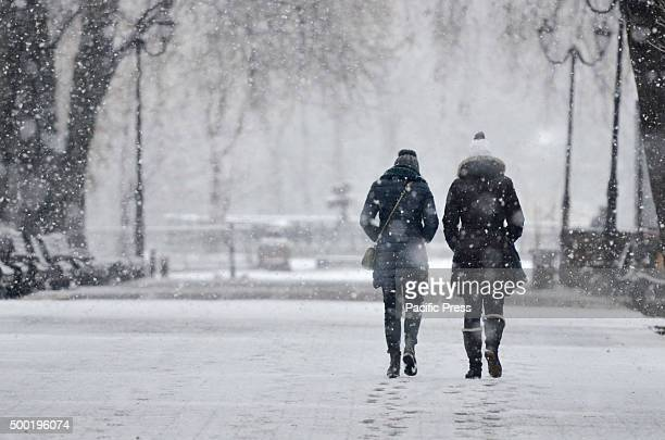 People walking through snowfall in Kiev Snow and rain is expected for the following week in Ukraine based on the weather forecast