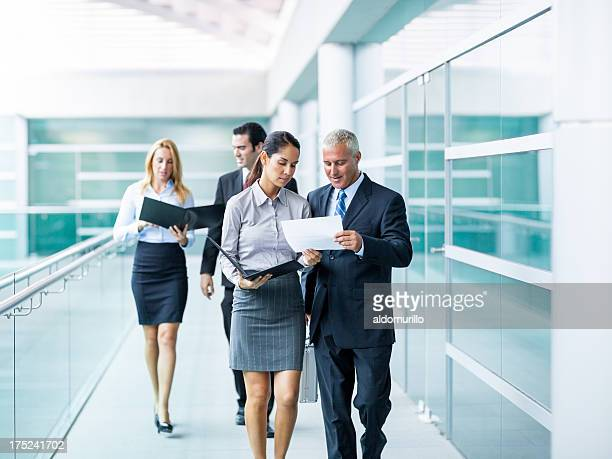 People walking through the office