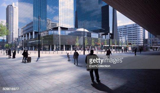 People walking towards business district