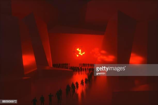 People walking towards glowing alien sphere