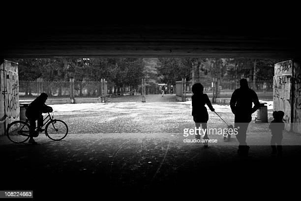People Walking Under Tunnel to Park. Black and White