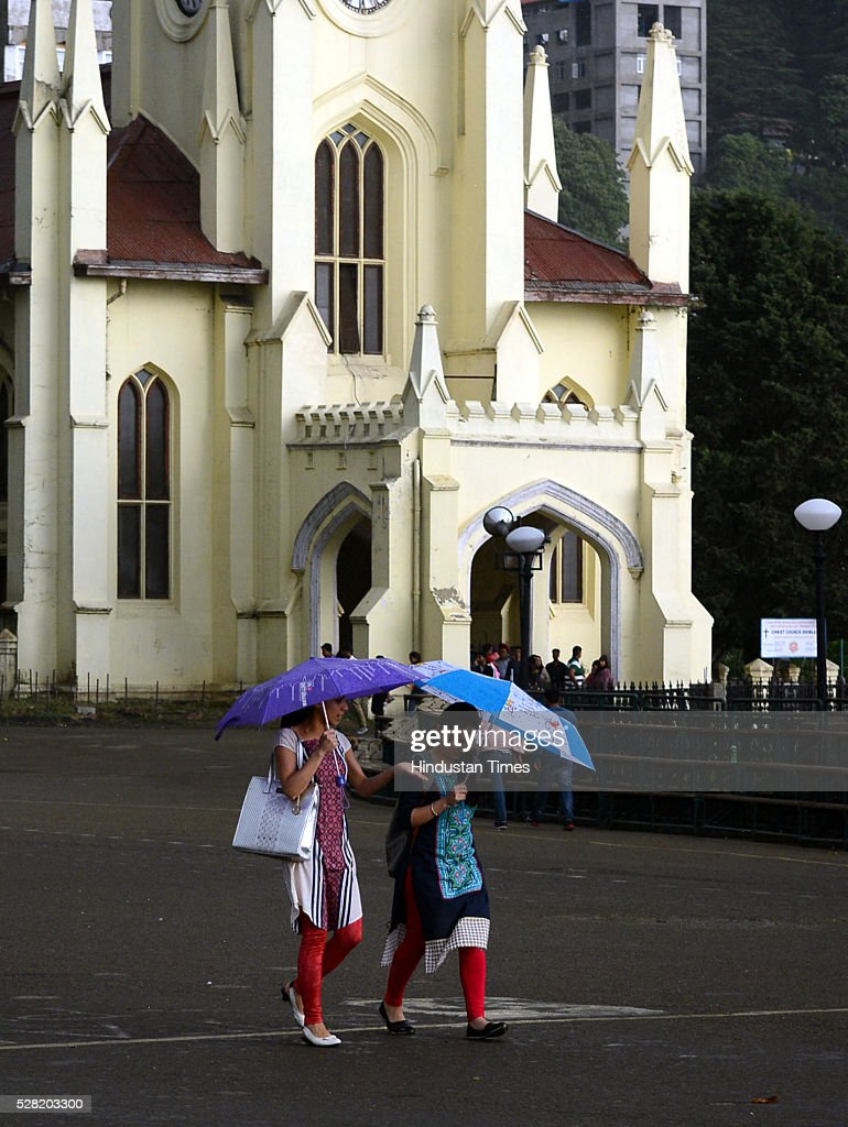 People walking with umbrella in rain at Ridge on May 4, 2016 in Shimla, India.