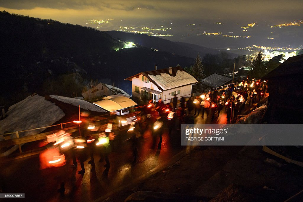 People walks as they pay their respects on January, 5, 2013 during a march in memory of the victims of a shooting in the village of Daillon. A gunman with psychiatric and drug problems killed three women and wounded two men on January 3, 2013 in a shooting spree in the tiny village where he lived in the mountains of southern Switzerland. Police shot and wounded the suspect after he threatened them with a gun following the attack in Daillon that raised fresh questions about the country's liberal gun ownership laws.