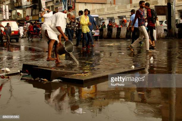 People walks during a rainfall in Delhi India on May 21 2017